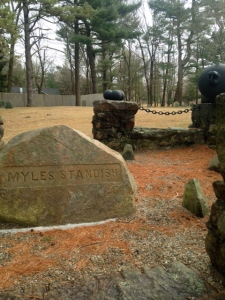 The three sided field stones, seen to the right, are still part of Myles Standish's more elaborate memorial.